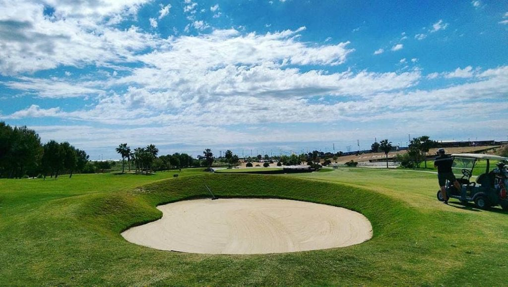 In Lo Romero Golf, the approach to 18th island green