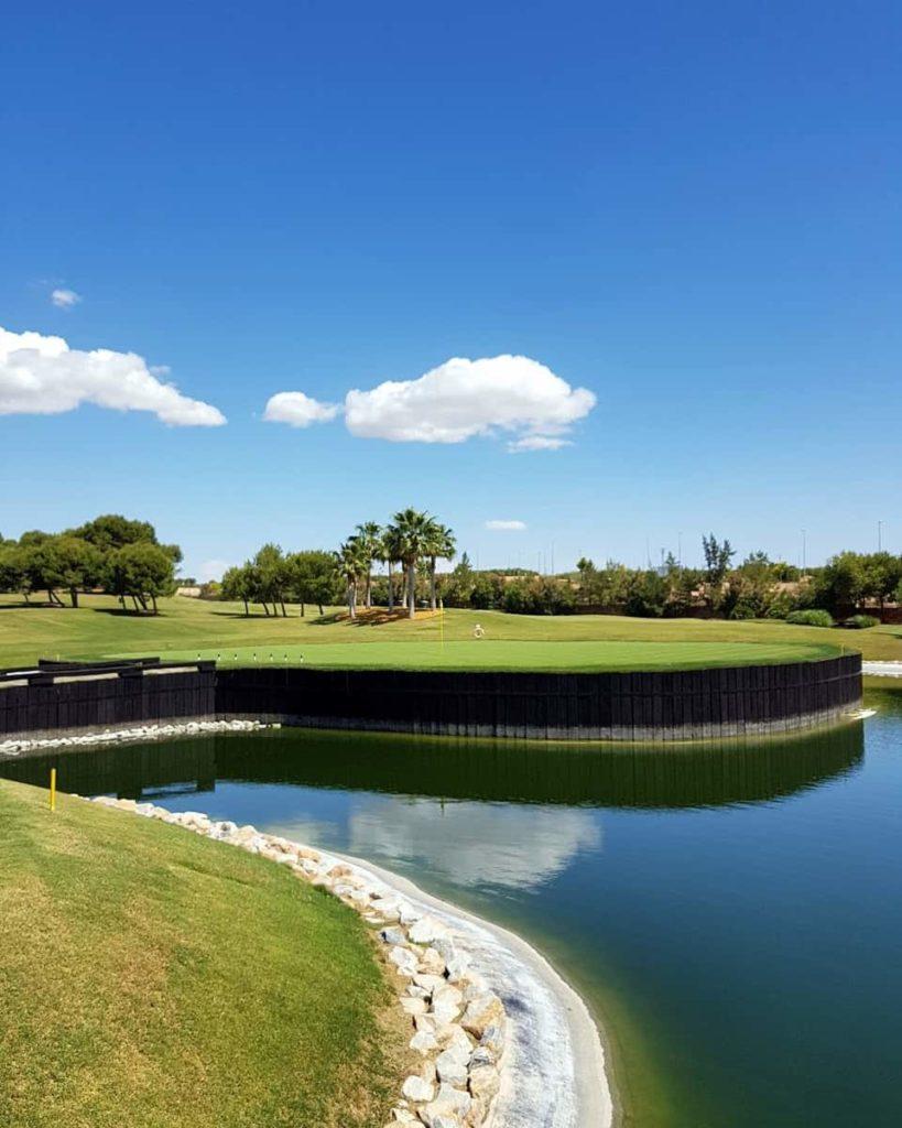 18th green, island hole in Lo Romero Golf